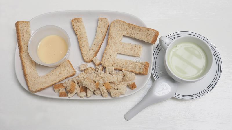 Love breakfast create idea are bread and tofu green tea milk. Love breakfast create idea from whole wheat bread and sweetened condensed milk, serve with Tofu stock photography