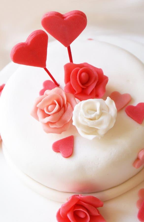 Love cake. On white plate stock photo