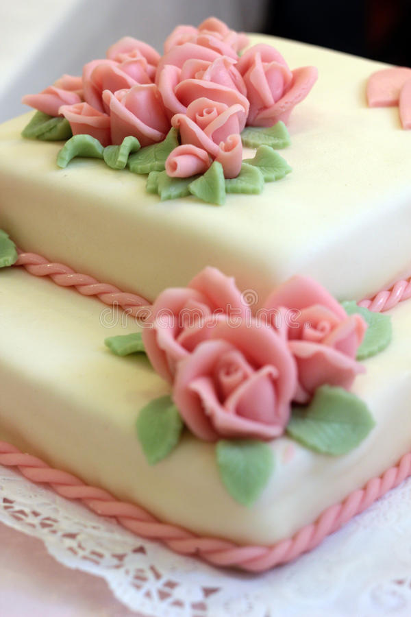 Love cake. On white plate stock image