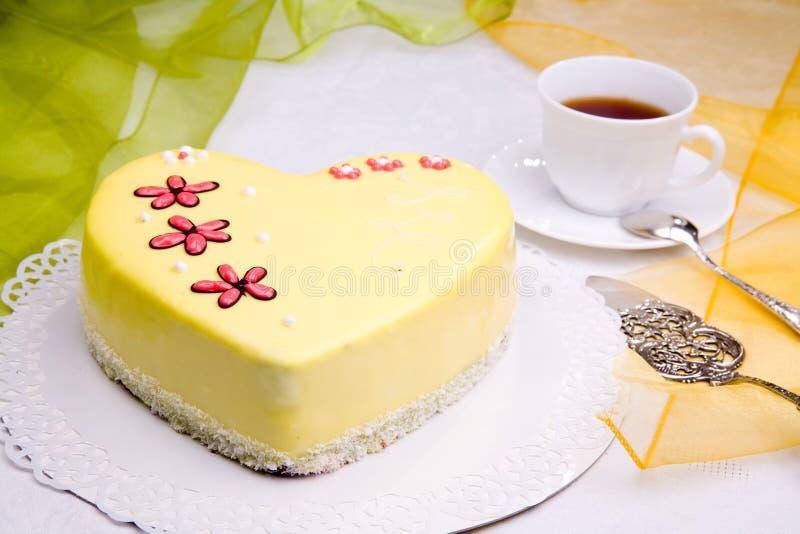 Love cake. Sweet love cake with flowers - heart shape stock image