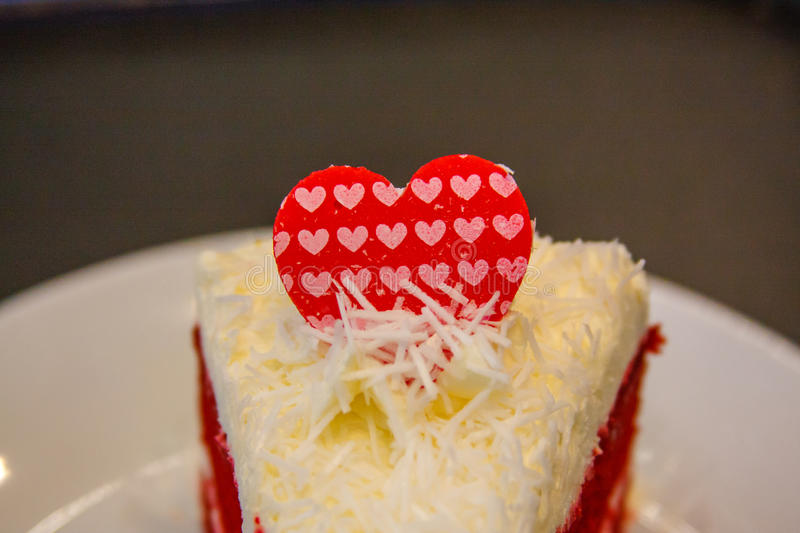 Love cake!. Love cake with coconut cream and chocolate hearts. Valentines Day stock images