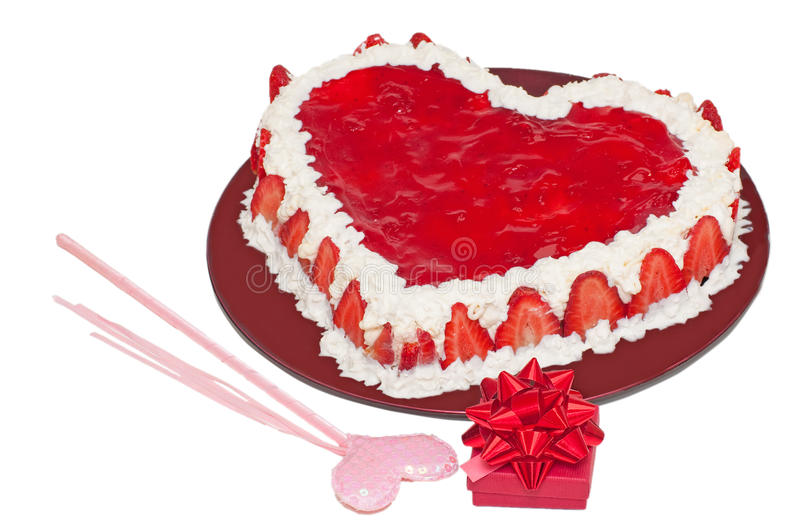Love cake and present. Valentine's day red love cake and present box with ribbon royalty free stock photo