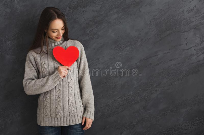 Kind woman with red paper heart stock photography
