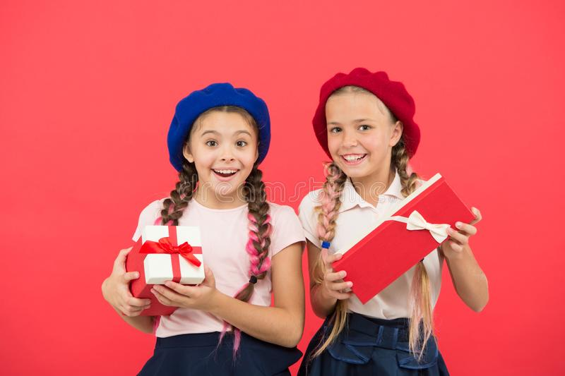 We love christmas. Small cute girls received holiday gifts. Best toys and christmas gifts. Kids little sisters hold stock photography