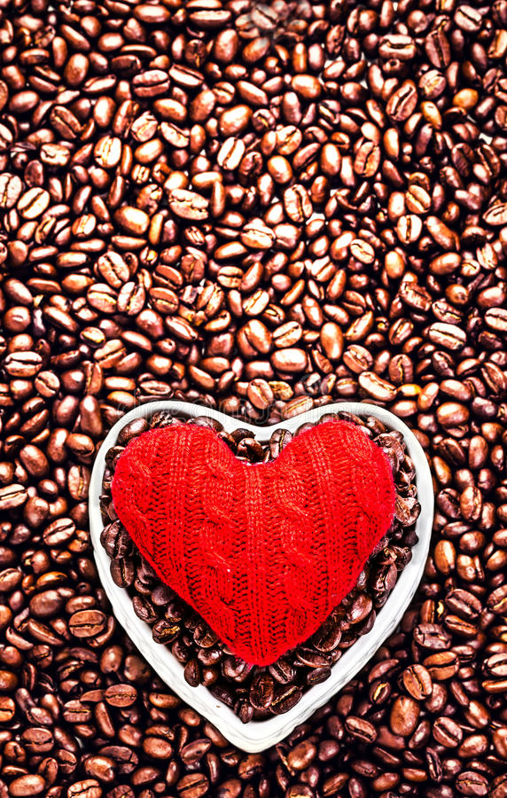 Love Coffee at Valentine's Day. Roasted Coffee Beans with Red He. Art over coffee beans background with copy space for greeting text. Wedding, love, holiday stock images