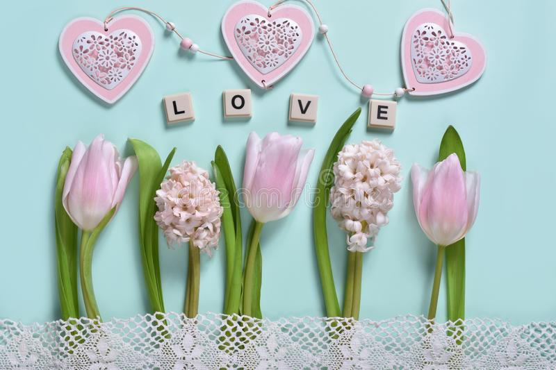 Love concept background with flowers and hearts stock photography