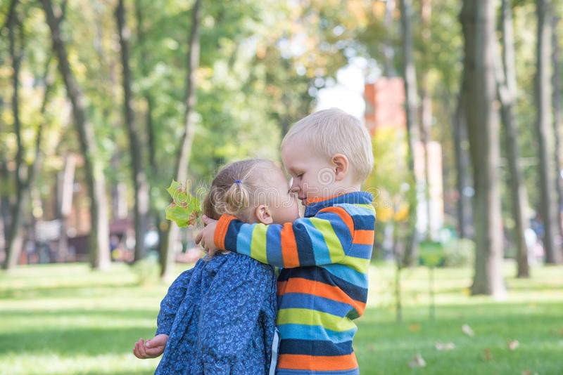 Love concept. Couple of kids loving each other hugging and kissing. royalty free stock image