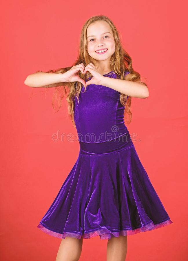 Love concept. Girl cute child show heart shaped hand gesture. Love and sympathy. Symbol of love. Kid adorable girl with. Long hair smiling face show heart royalty free stock photo