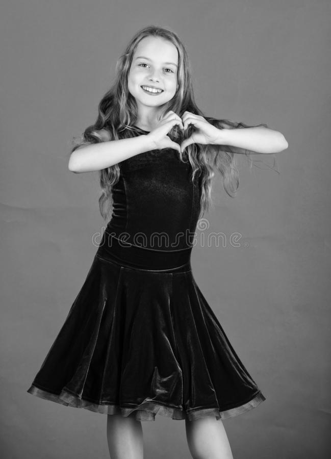 Love concept. Girl cute child show heart shaped hand gesture. Love and sympathy. Symbol of love. Kid adorable girl with. Long hair smiling face show heart stock image