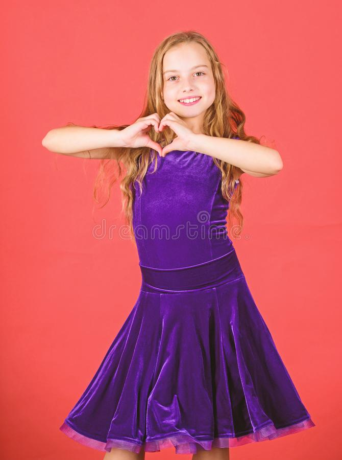 Love concept. Girl cute child show heart shaped hand gesture. Symbol of love. Kid adorable girl with long hair smiling. Face show heart gesture to you stock images