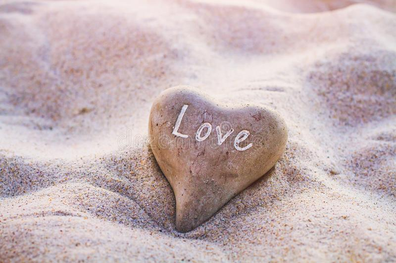 Love concept, heart on the sand royalty free stock photo