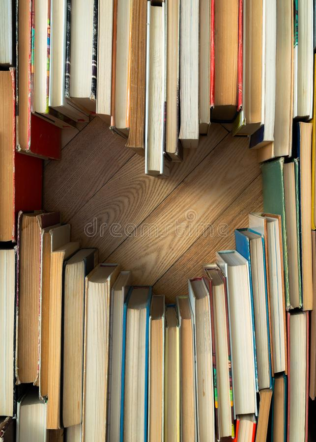 Love concept of heart shape from old vintage books on wooden flo royalty free stock images