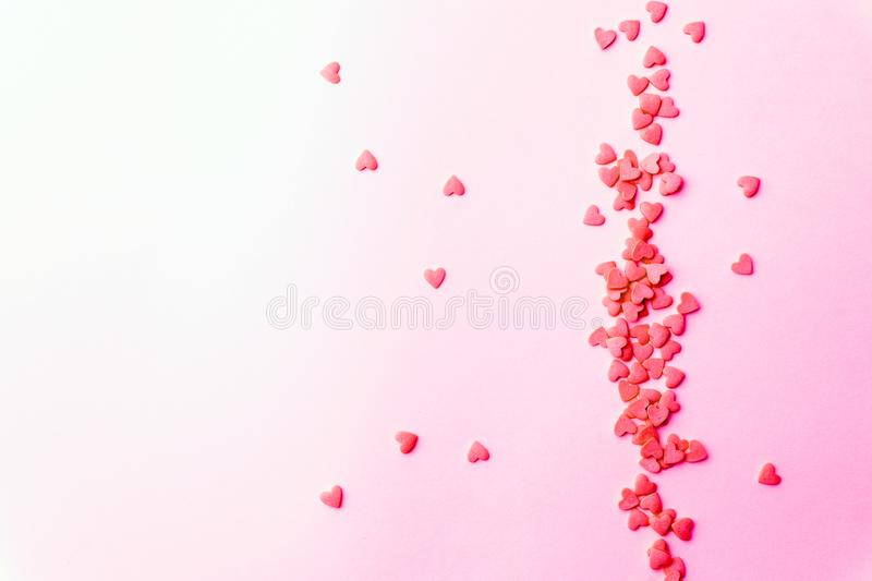Love concept minimal. Sweet sugar hearts on a colored background. Contemporary art design royalty free stock photo