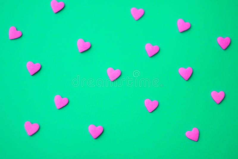 Love concept minimal. Sweet sugar hearts on a colored background. Contemporary art design royalty free stock photography