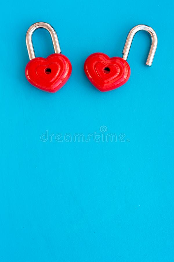 Love concept. Valentine`s day symbol. Locks in shape of heart on blue background top view space for text royalty free stock photography