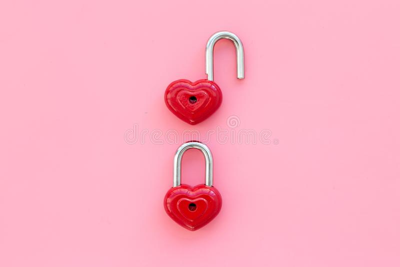Love concept. Valentine`s day symbol. Locks in shape of heart on pink background top view copy space royalty free stock image