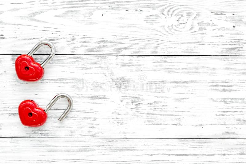 Love concept. Valentine`s day symbol. Locks in shape of heart on white wooden background top view space for text stock image