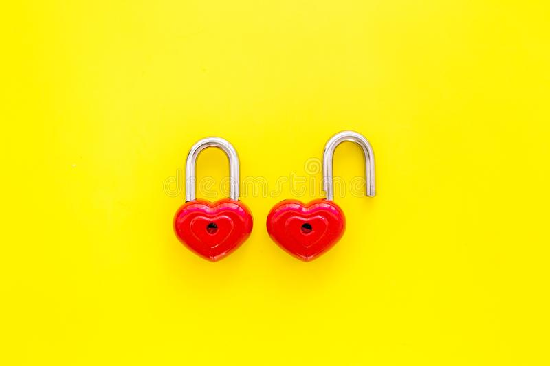 Love concept. Valentine`s day symbol. Locks in shape of heart on yellow background top view copy space royalty free stock photography