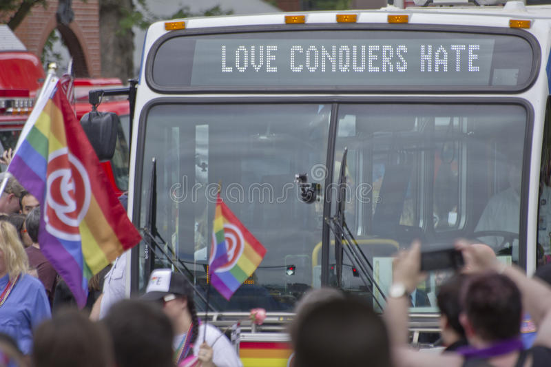 Love Conquers Hate gay pride parade bus in Portland, Oregon. A bus at a gay pride parade supported by a love conquers hate mantra royalty free stock photography