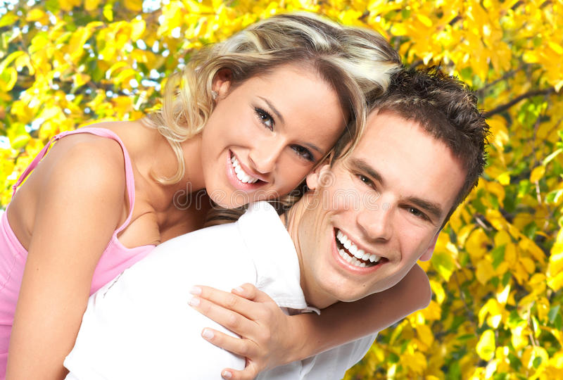 Love couple. Young happy smiling couple in love in park royalty free stock photography