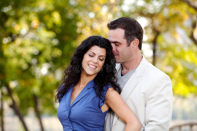 Love Couple. A man and woman showing affection in a park royalty free stock photo
