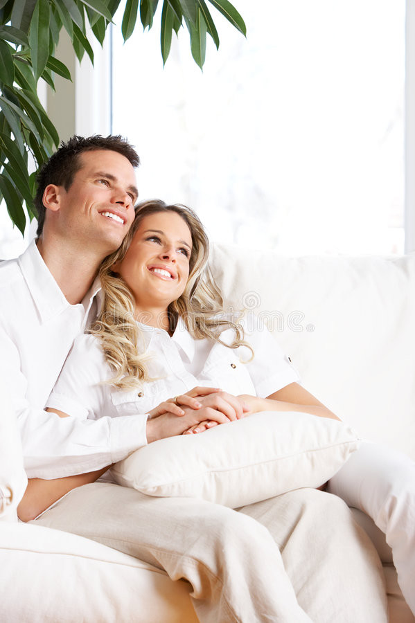 Love couple. Young love couple smiling in the comfortable apartment