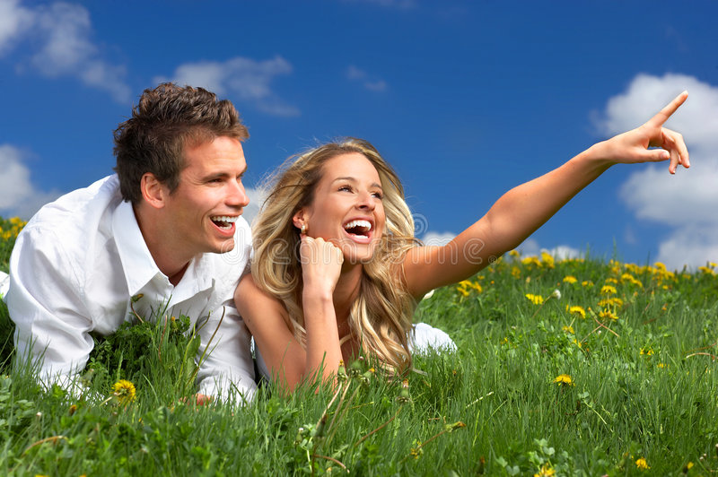 Love couple. Young love couple smiling under blue sky