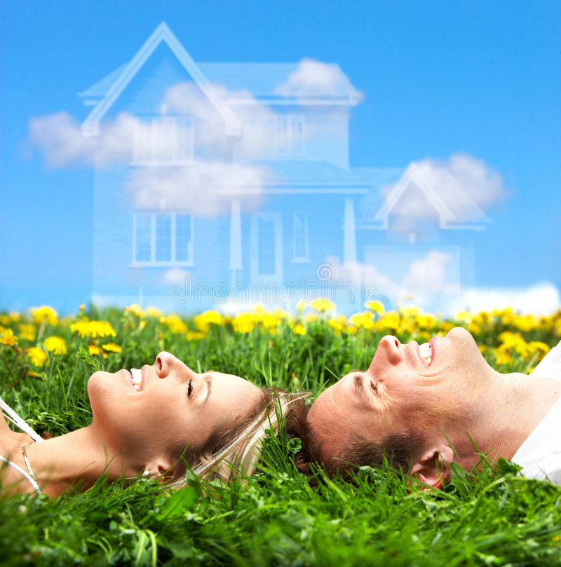 Love couple. Young love couple smiling dreaming about a new home. Real estate concept