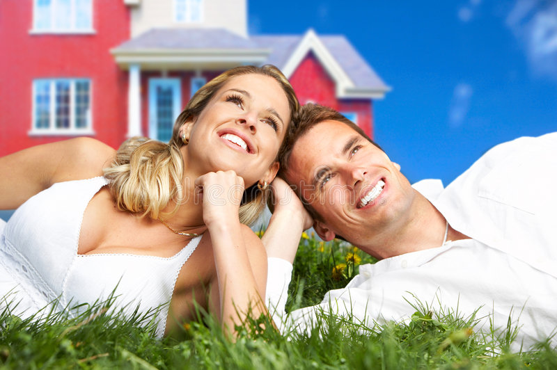 Love couple. Young love couple smiling dreaming about a new home. Real estate concept royalty free stock photos