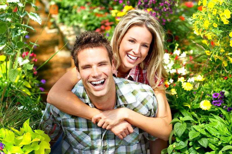 Love couple. Young happy love couple smiling in the garden stock photography