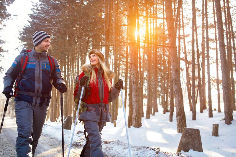 Love couple hiking on winter stock photography