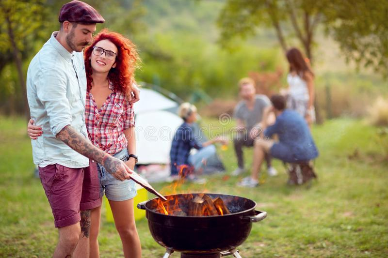 Love couple prepare fire on grill royalty free stock photography