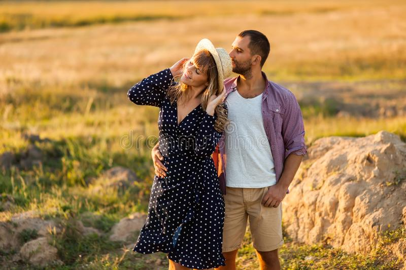 Love Couple in love romantic summer field happy royalty free stock images