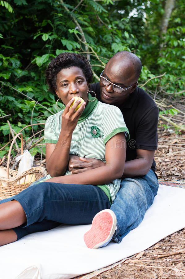Download Love Couple Sitting On A Mat In The Bush Stock Photo - Image: 83723012