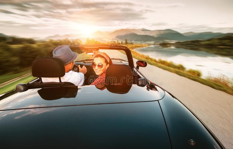 In love couple traveling by cabriolet car stock images