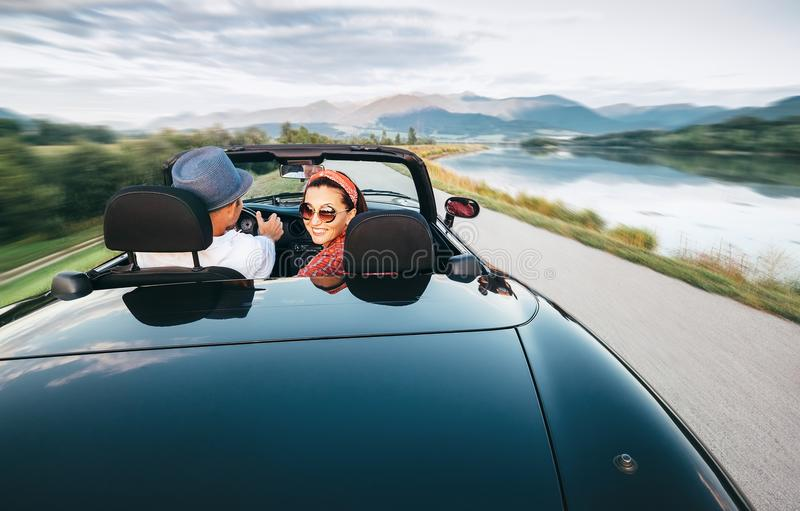 In love couple traveling by cabriolet car stock photos