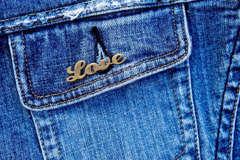 Love on denim. Pocket background royalty free stock photography