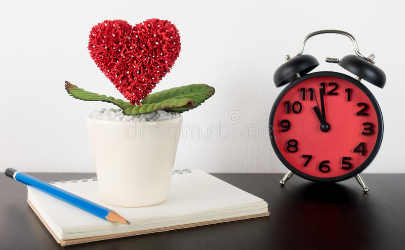 Love Diary story writing with clock stock image