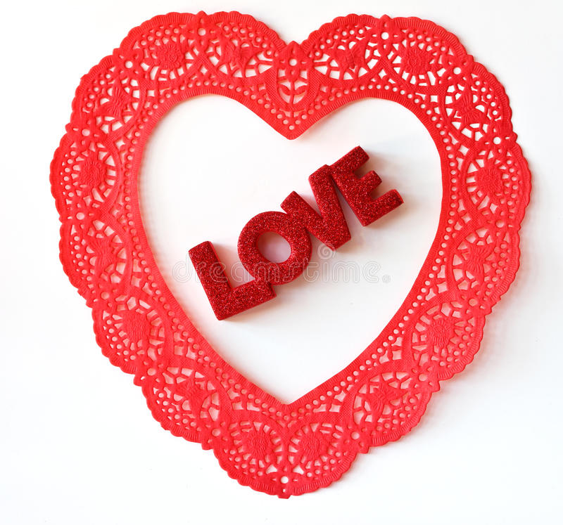 Love in a Doily Heart. The word Love in a Doily Heart on a white background royalty free stock photos