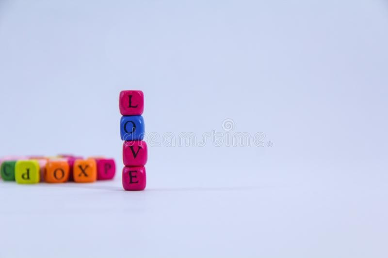 Love alphabet written on colourful stack wooden block with white background royalty free stock photography