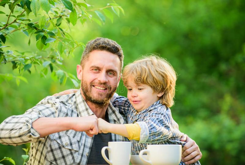 They love eating together. Weekend breakfast. healthy food. Family day bonding. father and son eat outdoor. small boy. Child with dad. organic and natural food royalty free stock images