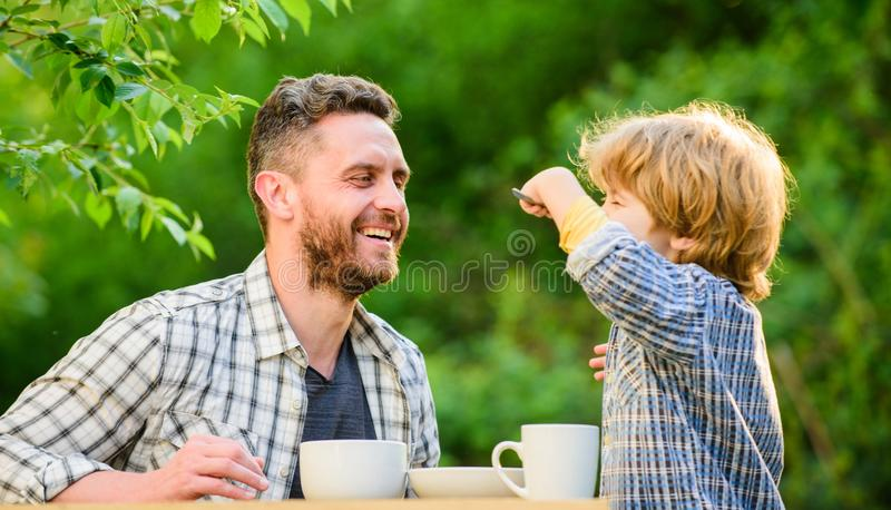 They love eating together. Weekend breakfast. healthy food. Family day bonding. small boy child with dad. organic and. Natural food. father and son eat outdoor royalty free stock photo