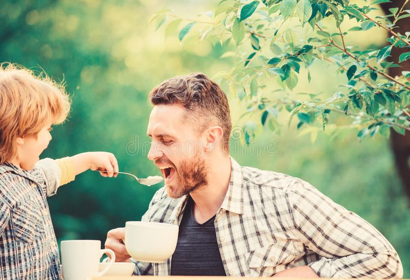 They love eating together. Weekend breakfast. small boy child with dad. organic and natural food. father and son eat stock photography