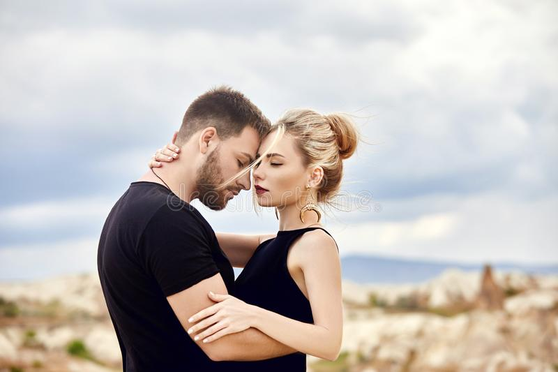 Love and emotions loving couple resting in Turkey. In love Eastern couple in the mountains of Cappadocia hugs and kisses. Close-up royalty free stock photo