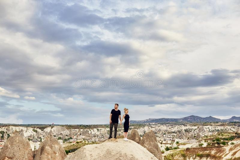 Love and emotions loving couple resting in Turkey. In love Eastern couple in the mountains of Cappadocia hugs and kisses. Close-up royalty free stock photography