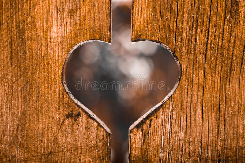 Love engraved in the wood stock image