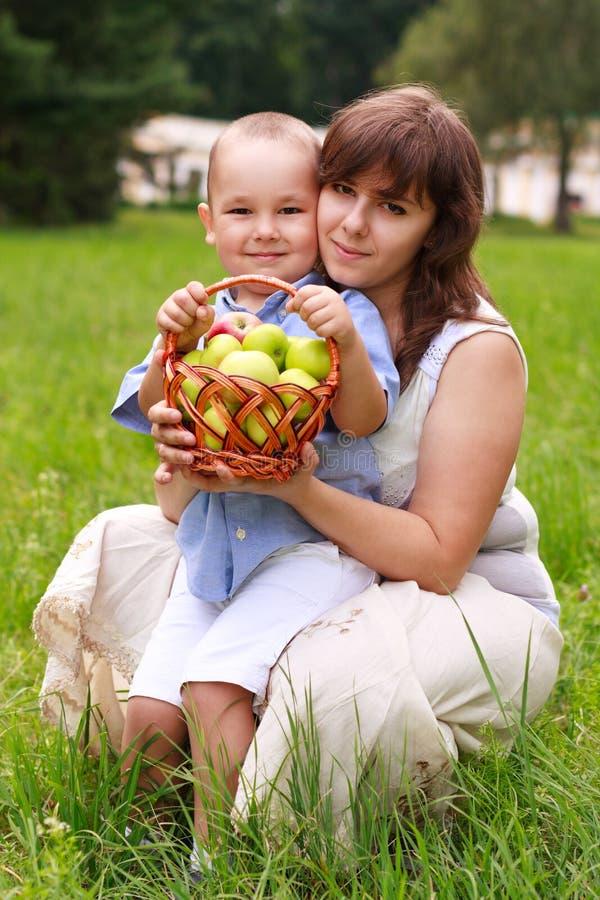 Love family having picnic in green park stock image