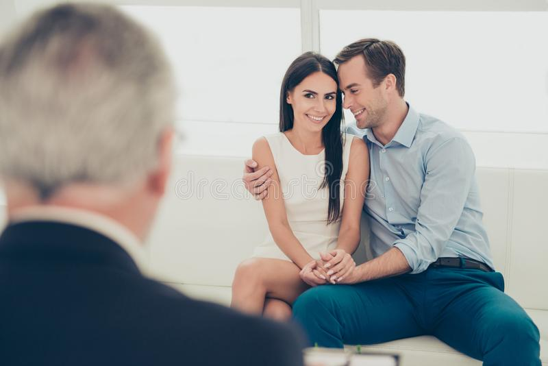 Love, family, phychology and happiness concept - young couple hugging at psychologist office, they are so happy, they cured from. Infertility stock images
