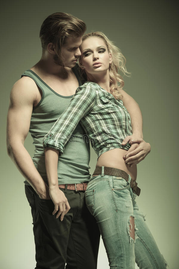 In love fashion couple. In an embraced pose stock images