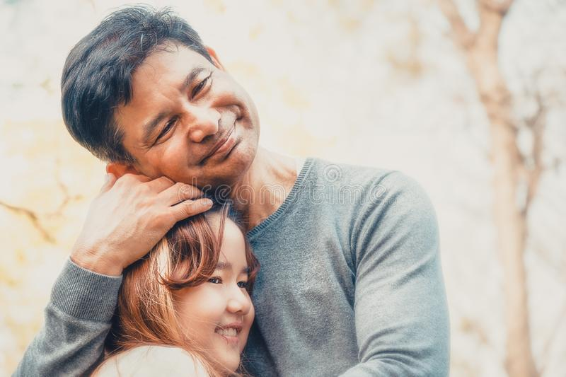 Love of father and daughter. Father hold little daughter with two arms with love royalty free stock image